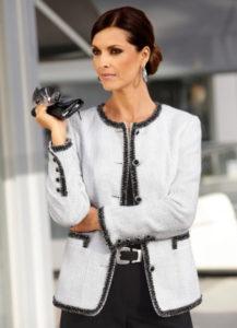 Твидовый пиджак и строгие черные брюки