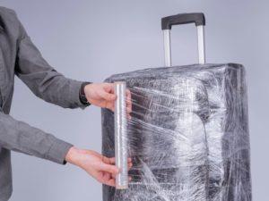 Как самому обмотать пленкой чемодан?