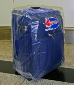 Синий чемодан в пленке