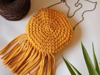 Желтая круглая сумка