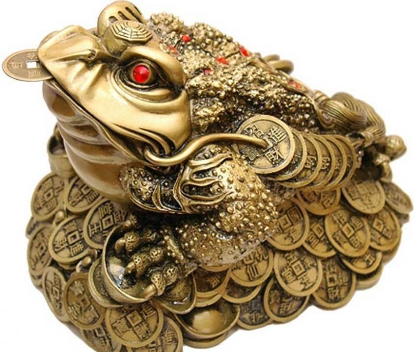 Трехногая жаба с монетой во рту