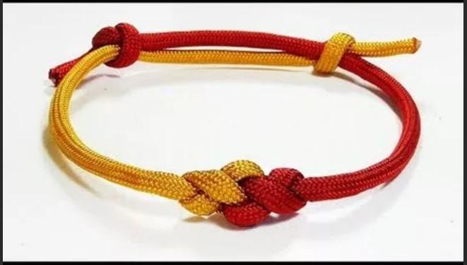 скользящий узел желто-красный браслет