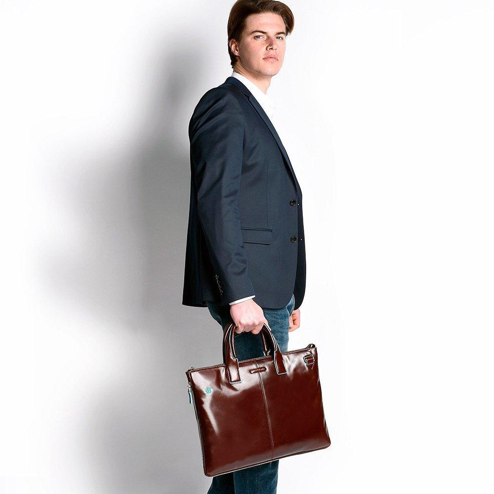 Коричневая мужская сумка.