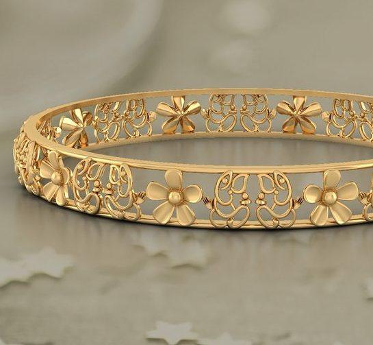 Золотой браслет флористического дизайна.