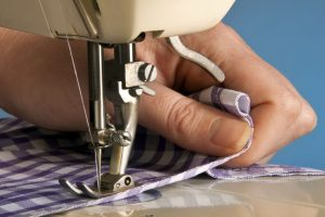 Натяжение нитей в швейной машине