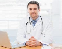 depositphotos_39179963-stock-photo-male-doctor-with-laptop-at